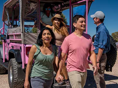 Hermits Rest Tour passengers exiting the rear of a custom Pink® Jeep® vehicle
