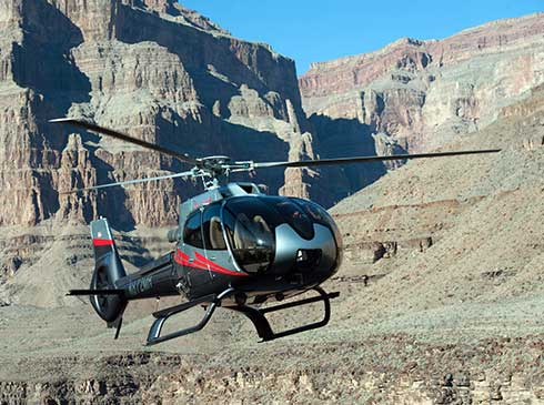 ECO Star Helicopter flying beneath the West Rim of Grand Canyon