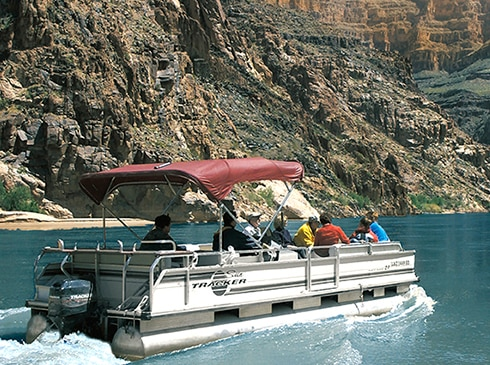 Grand Canyon West Drive, Fly, Float Combo guests explore the Colorado River from power pontoon boat