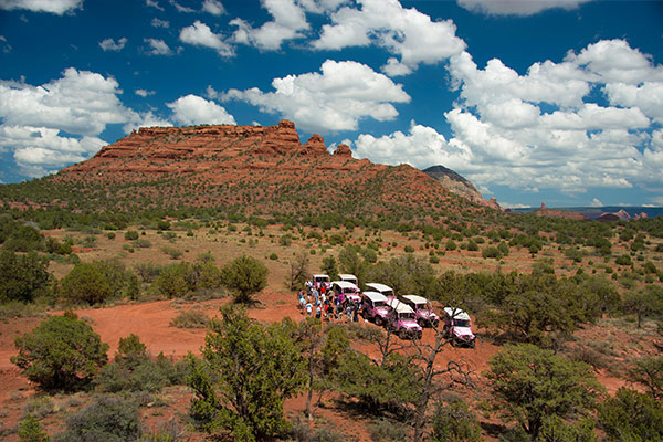 Wedding in Sedona - group of Pink Jeeps and people