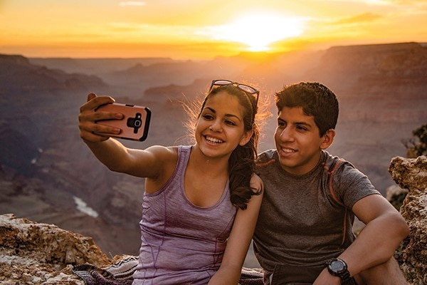 Kids taking selfie at Grand Canyon