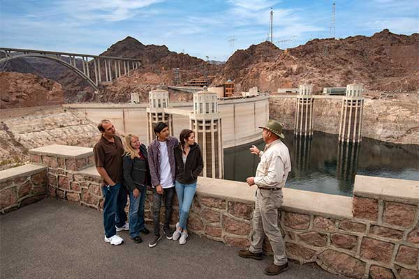 Tour group at Hoover Dam with Pink Jeep guide