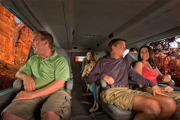 Tour guests riding inside Pink Adventure Trekker vehicle to Hoover Dam