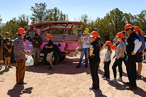 Pink Jeep Tours volunteers gathering for trail work