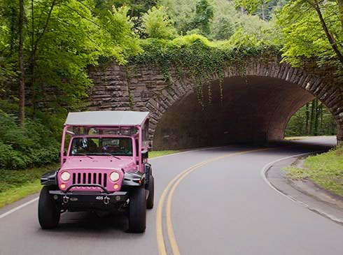 Pink® Jeep® Tour vehicle exiting Newfound Gap Tunnel, Great Smoky Mountains National Park
