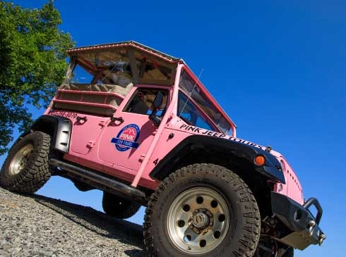 Pink Jeep descending steep, rocky hill on Smoky Mountain off-road trail near Pigeon Forge