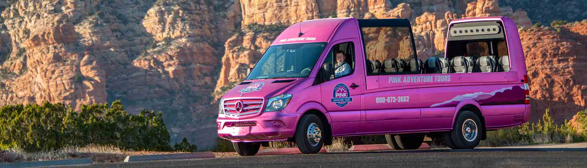 Close-up of Pink® Adventure® Tours PanoramaVan with Sedona's Thunder Mountain in background