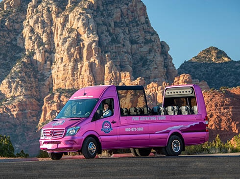 Pink® Adventure® Tours PanoramaVan parked with Sedona's Thunder Mountain in background