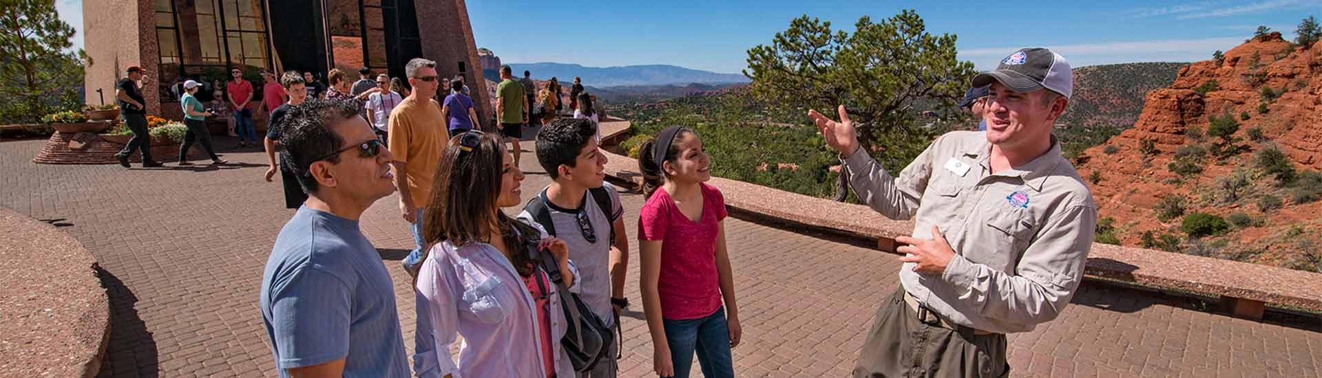 Pink Jeep Tour guide talking with guests on the Sedona 360 Tour at the Chapel of the Holy Cross