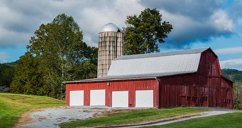 Scenic view of red barn and silo in Wears Valley, near Great Smoky Mountains, TN