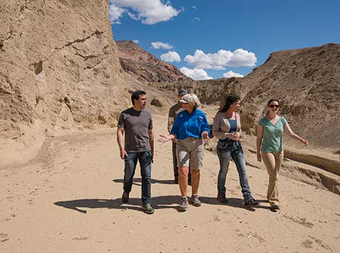 Group walking with a tour guide in Death Valley National Park.