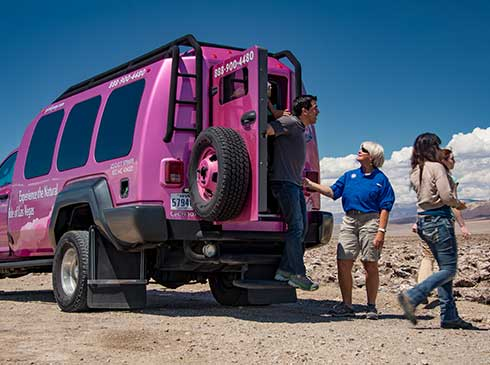 Guests exiting Pink Jeep Tour Trekker at Death Valley.