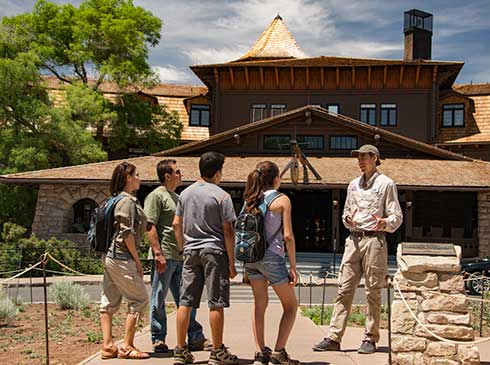 Pink Jeep guide talking with tour group in front of El Tovar Hotel, Grand Canyon South Rim