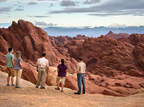 Pink Jeep guide and guests viewing geological formations at Valley of Fire State Park, Nevada