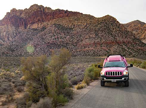 Pink® Jeep Tour Trekker traveling the 13-mile scenic drive through Red Rock Canyon, NV