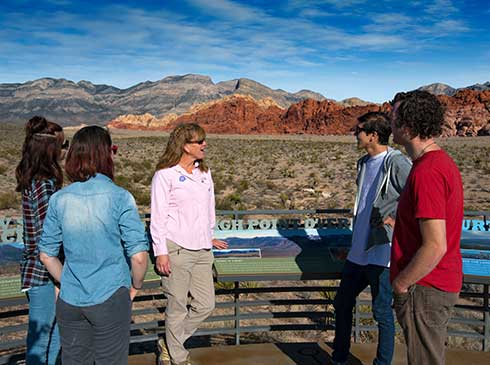 Pink Jeep interpretive guide talking with guests at Dedication Overlook in Red Rock Canyon, Las Vegas