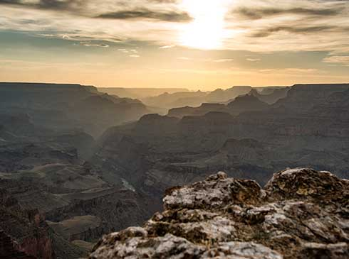 Golden sunset with Grand Canyon cliffs in foreground
