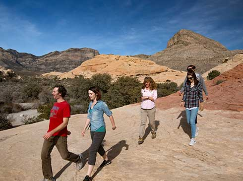 Guests scurry over jumbled sandstone formations in Red Rock Canyon outside Las Vegas.