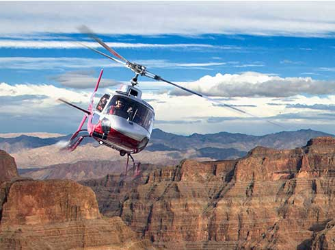 Tour guests descending 4,000 feet below the rim of Grand Canyon in a helicopter